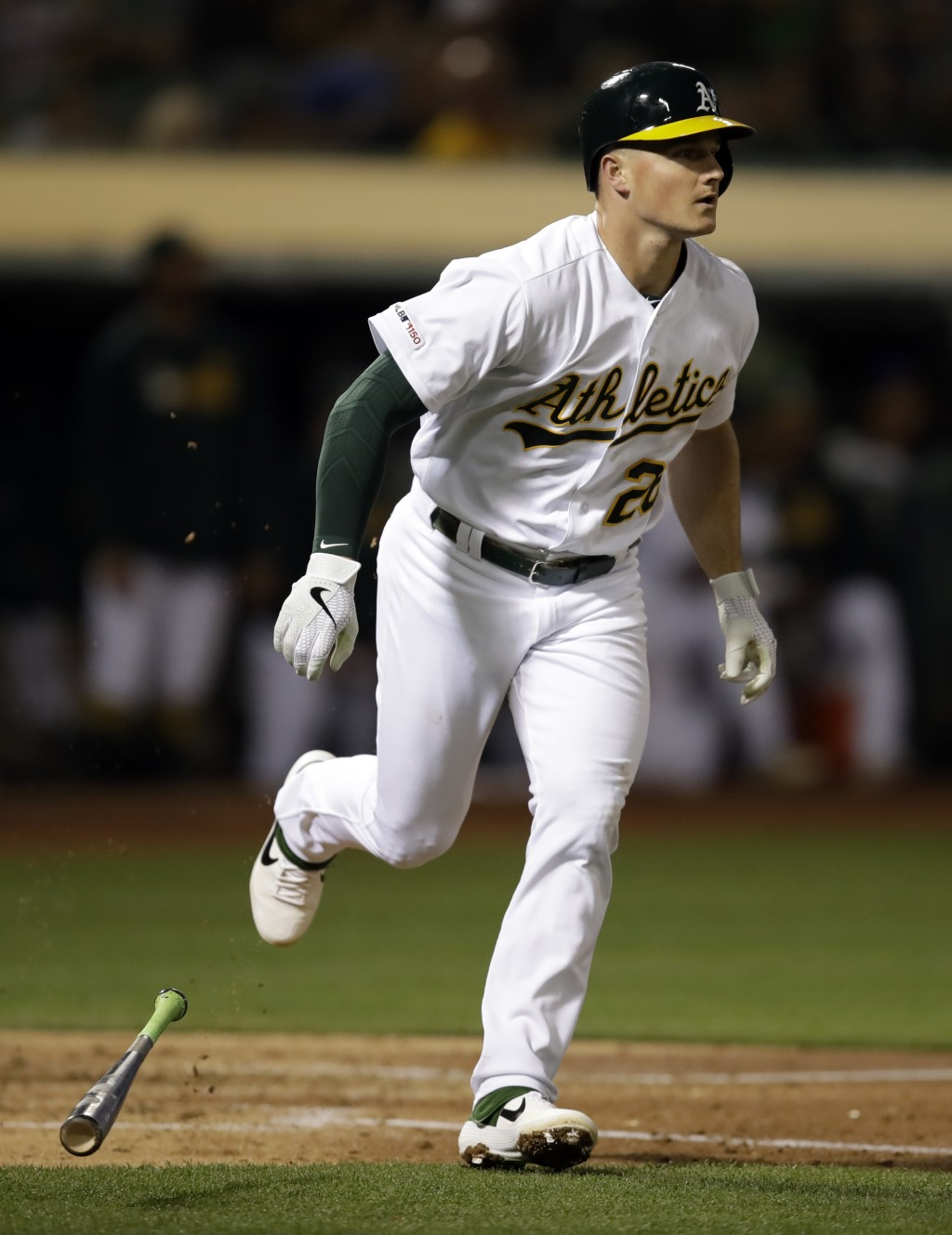 Oakland Athletics' Matt Chapman runs to first base after hitting an RBI-sacrifice fly against the Texas Rangers in the third inning of a baseball game