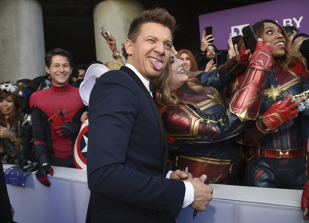 """Jeremy Renner takes a selfie with a fan as he arrives at the premiere of """"Avengers: Endgame"""" at the Los Angeles Convention Center on Monday, April 22,..."""