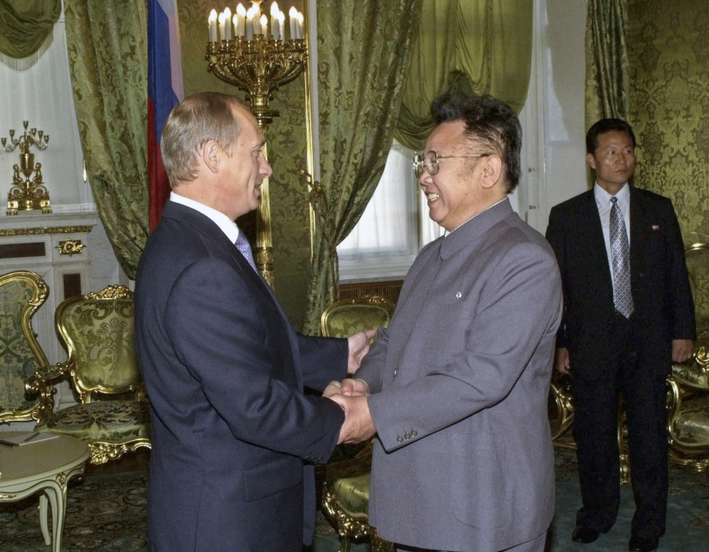 FILE In this Saturday, Aug. 4, 2001 file photo, Russian President Vladimir Putin, left, shakes hands with North Korean leader Kim Jong Il, during thei