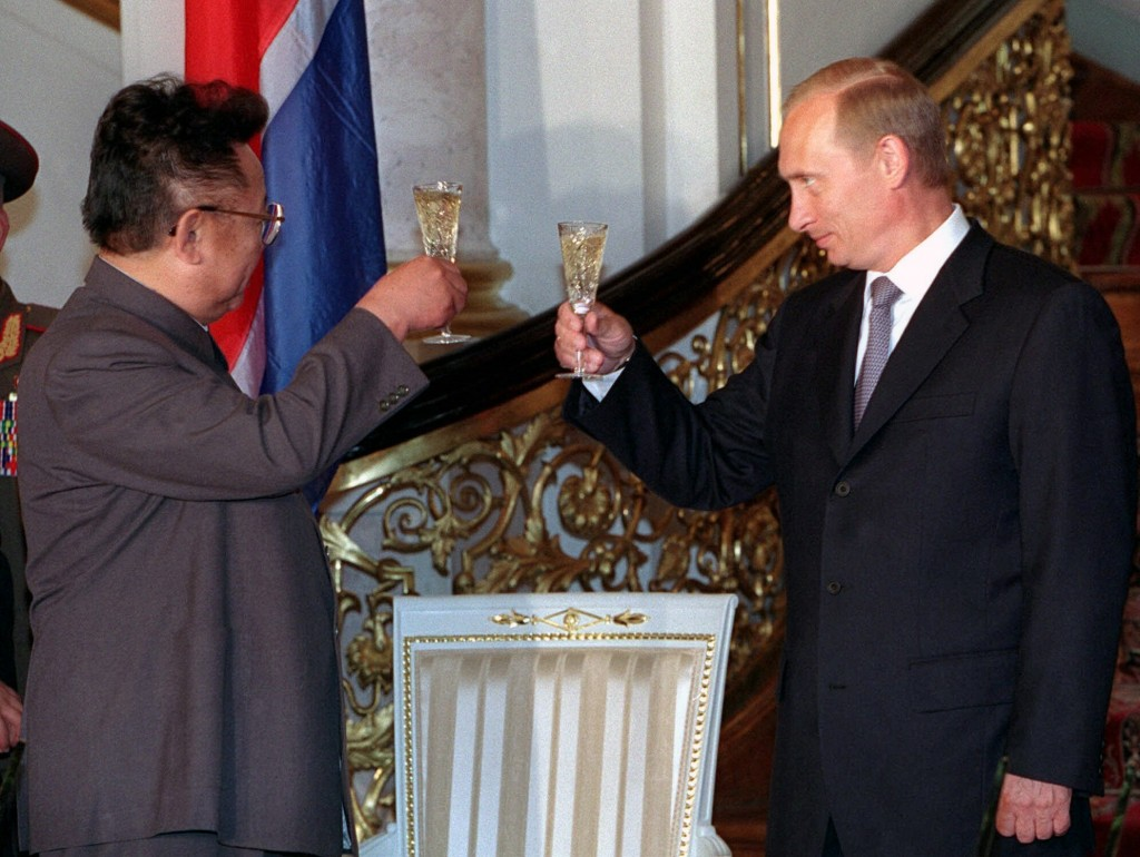 FILE - In this file Saturday, Aug. 4, 2001 file photo, Russian President Vladimir Putin, right, clinks glasses with North Korean leader Kim Jong Il du...