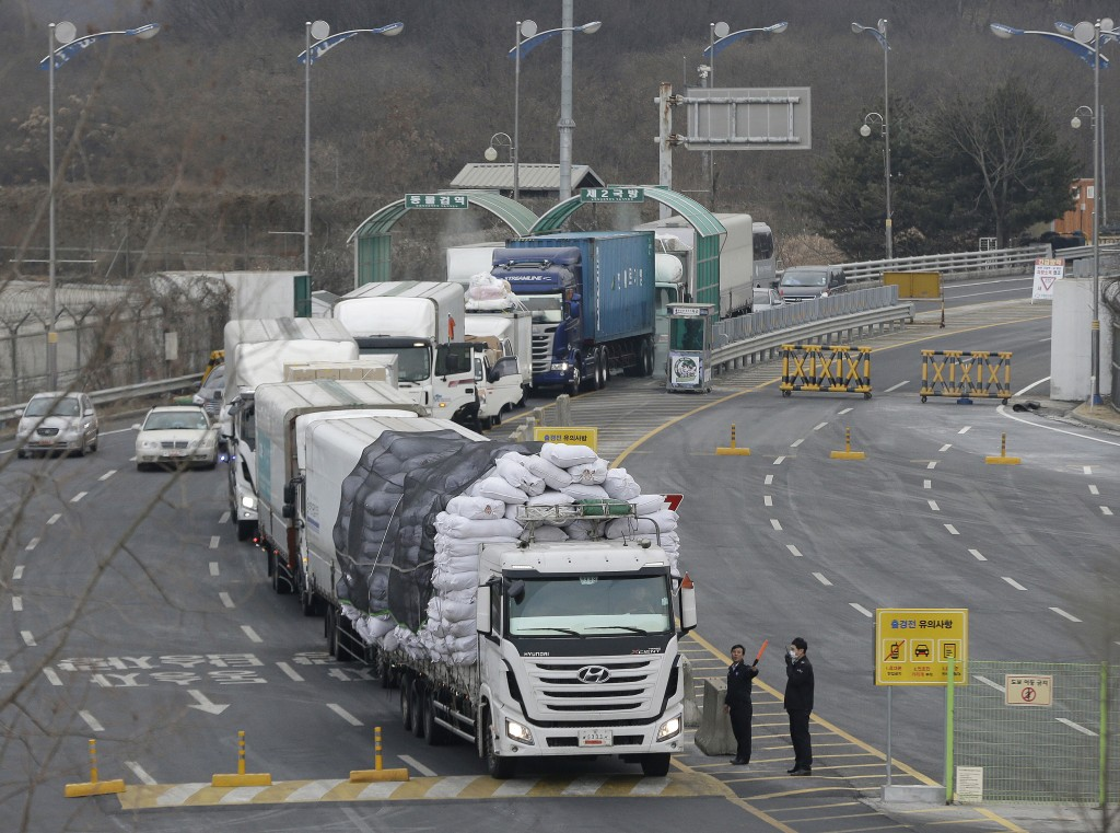 FILE - In this Feb. 11, 2016, file photo, South Korean vehicles returning from North Korea's joint Kaesong Industrial Complex pass the customs, immigr...