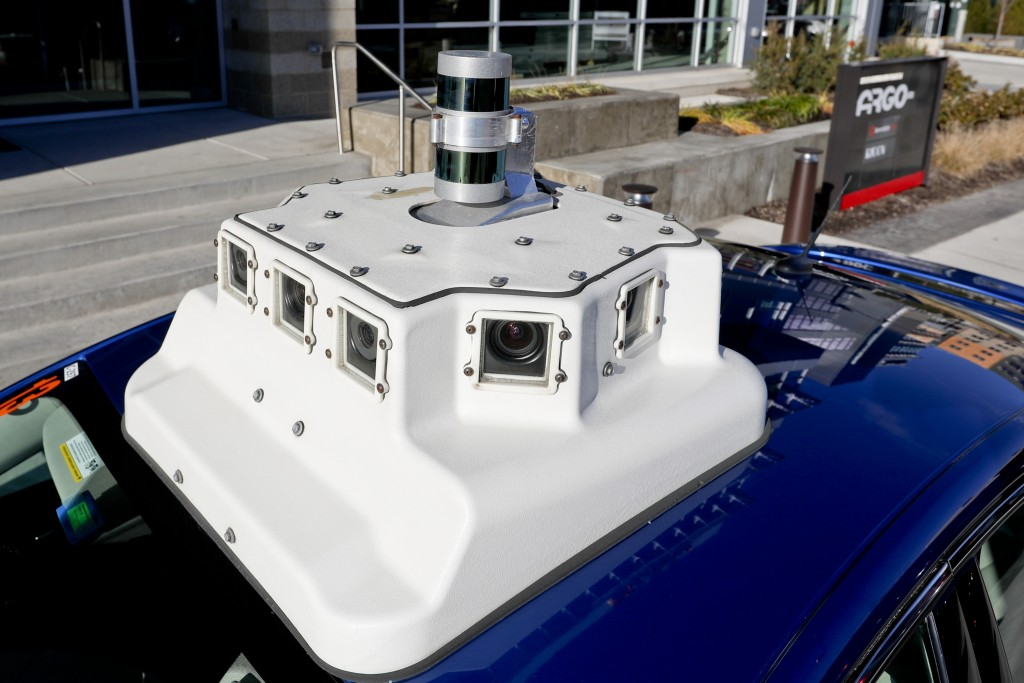 In this Dec. 18, 2018, photo, a sensor and camera array on top of one of the test vehicles from Argo AI, Ford's autonomous vehicle unit, is parked at ...