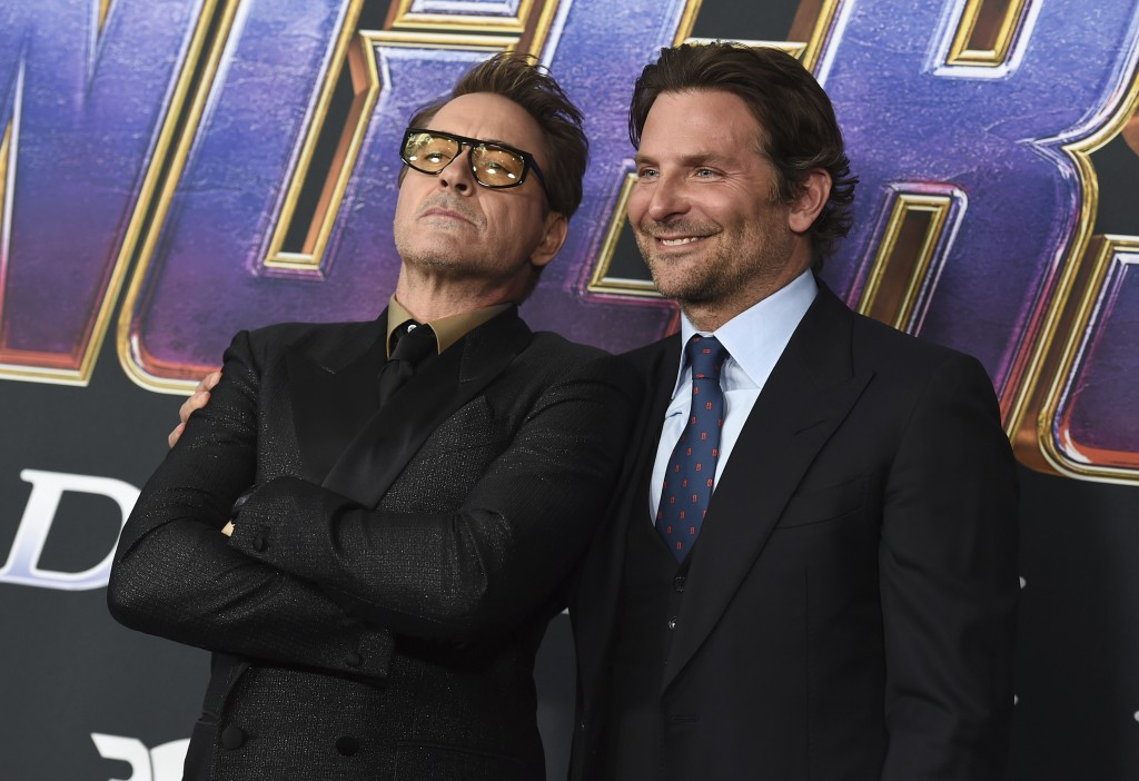 """Robert Downey Jr., left, and Bradley Cooper arrive at the premiere of """"Avengers: Endgame"""" at the Los Angeles Convention Center on Monday, April 22, 20..."""