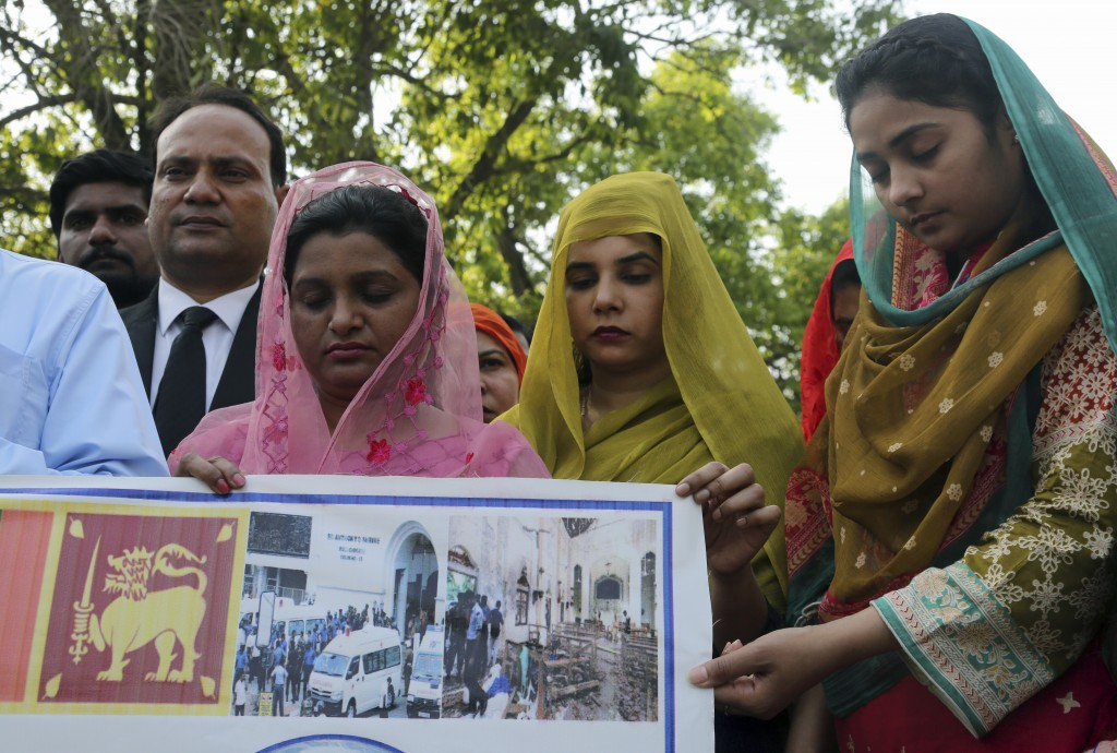 People attend special prayers for the victims of bomb explosions in churches and hotels in Sri Lanka, in Lahore, Pakistan, Monday April 22, 2019. (AP ...