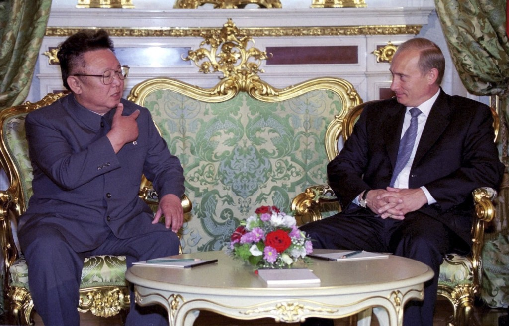 FILE - In this file Saturday, Aug. 4, 2001 file photo, Russian President Vladimir Putin, right, listens to North Korean leader Kim Jong Il, during the