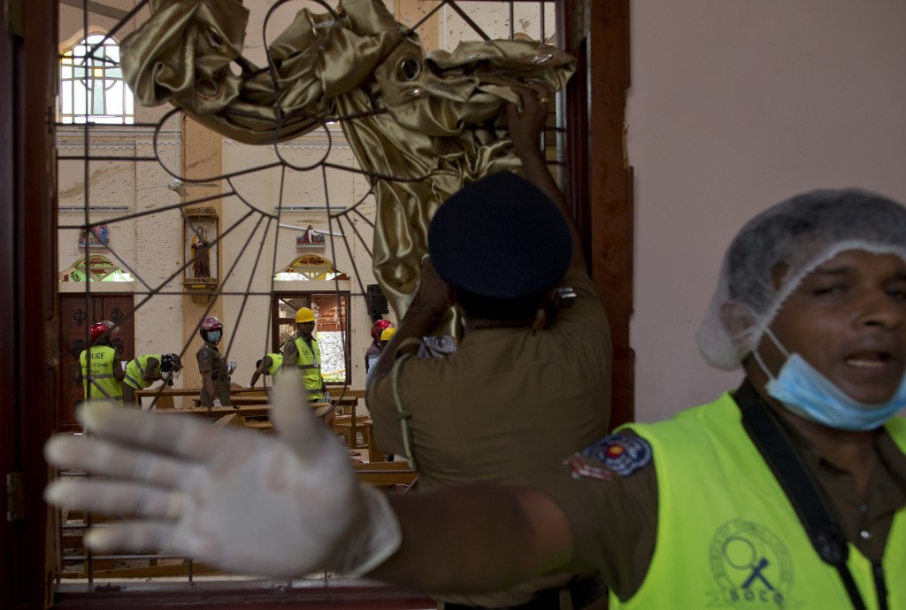 Investigators at the scene of a suicide bombing at St. Sebastian Church in Negombo, Sri Lanka, Monday, April 22, 2019. Easter Sunday bombings of churc