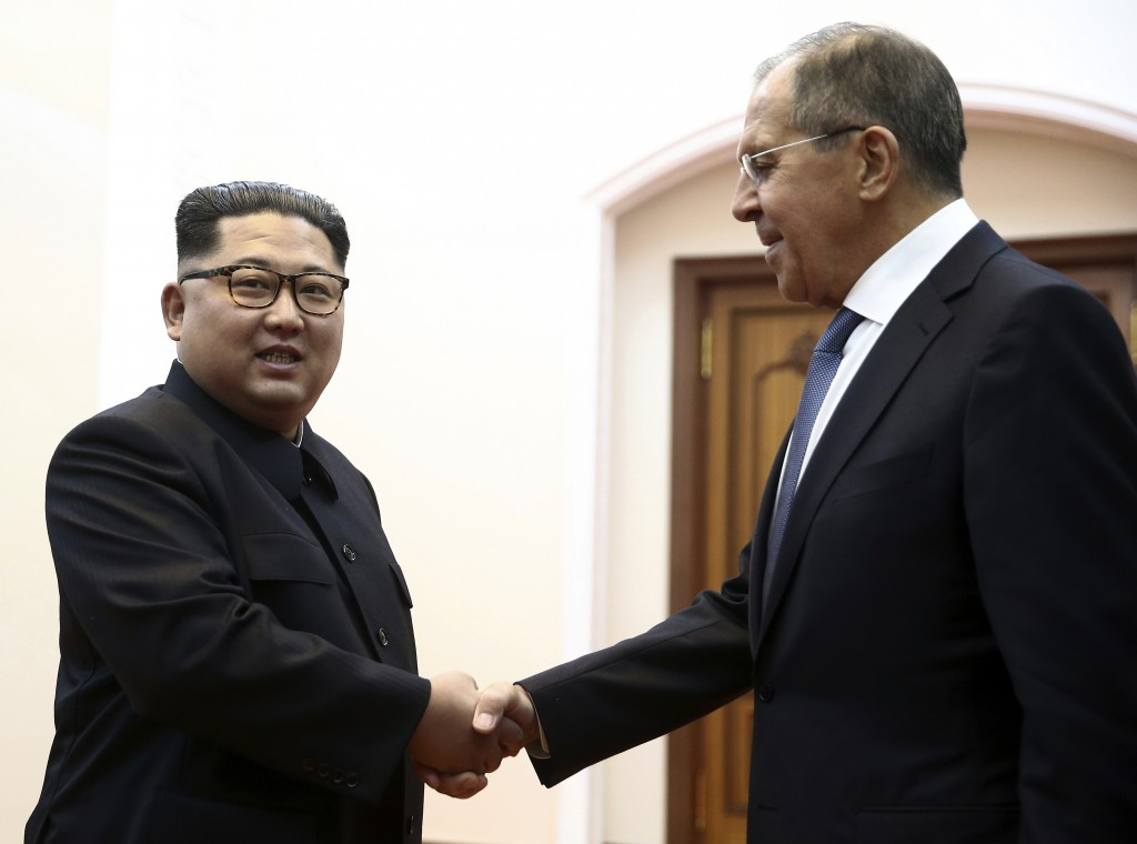 FILE - In this Thursday, May 31, 2018 file photo, Korean leader Kim Jong Un, left, and Russia's Foreign Minister Sergei Lavrov shake hands during a me...