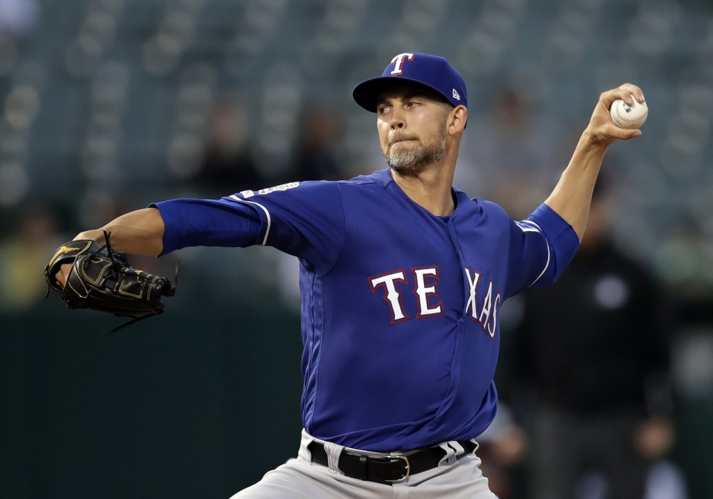 Texas Rangers pitcher Mike Minor works against the Oakland Athletics in the first inning of a baseball game Monday, April 22, 2019, in Oakland, Calif.