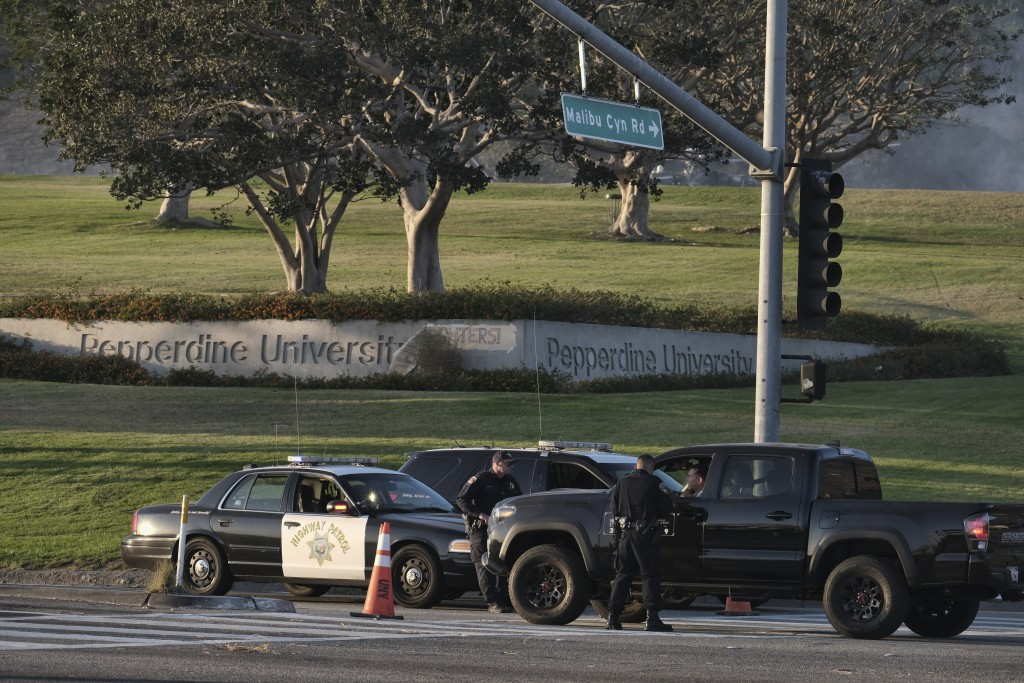 FILE - In this Nov. 11, 2018, file photo, California Highway Patrol block off the Pacific Coast Highway in front of Pepperdine University in Malibu, C...