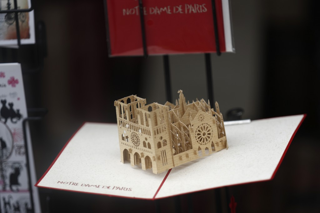 A replica of Notre Dame cathedral goes on sale in a souvenirs shop ,Tuesday, April 23, 2019 in Paris. Notre Dame isn't expected to reopen to the publi...