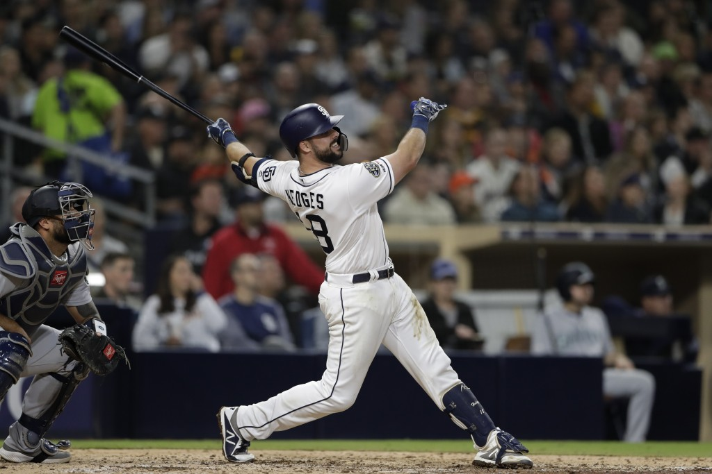San Diego Padres' Austin Hedges watches his two-run home run hit during the sixth inning of a baseball game against the Seattle Mariners, Tuesday, Apr...
