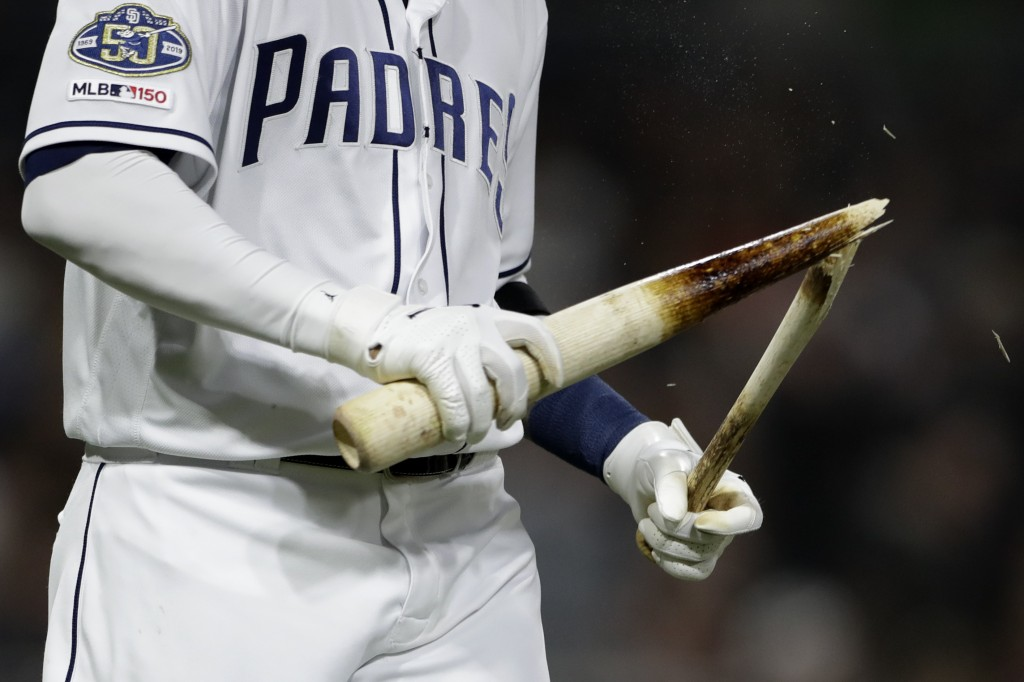 San Diego Padres' Manny Machado holds his broken bat after lining out to end the fifth inning of a baseball game against the Seattle Mariners, Tuesday...