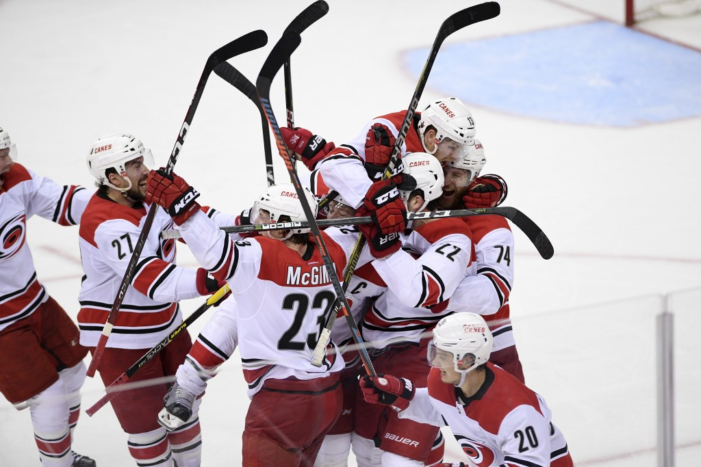 The Carolina Hurricanes celebrate after Game 7 of an NHL hockey first-round playoff series against the Washington Capitals, Wednesday, April 24, 2019,...