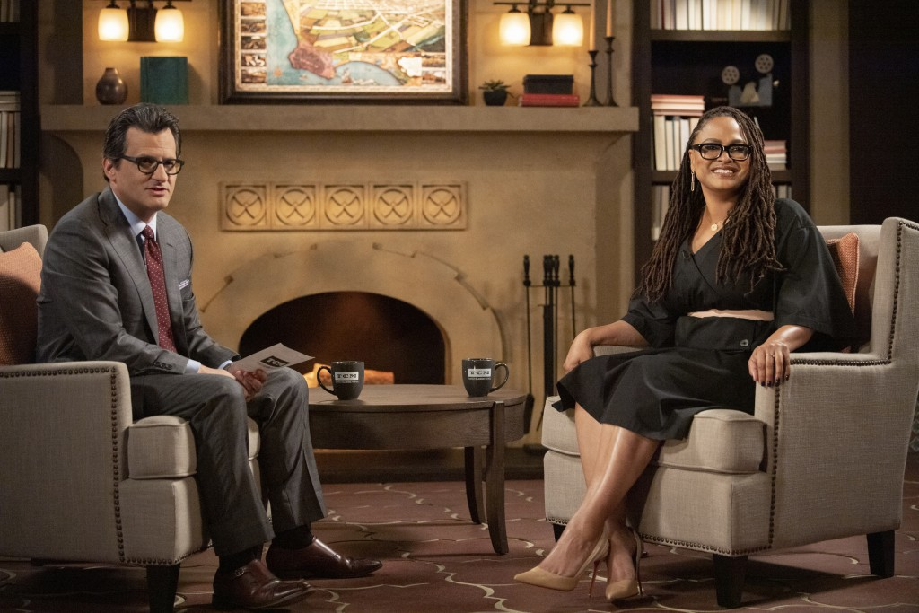 This image released by TCM shows TCM Primetime host Ben Mankiewicz, left, and director Ava DuVernay who is bringing 17 of her favorite classic films t...