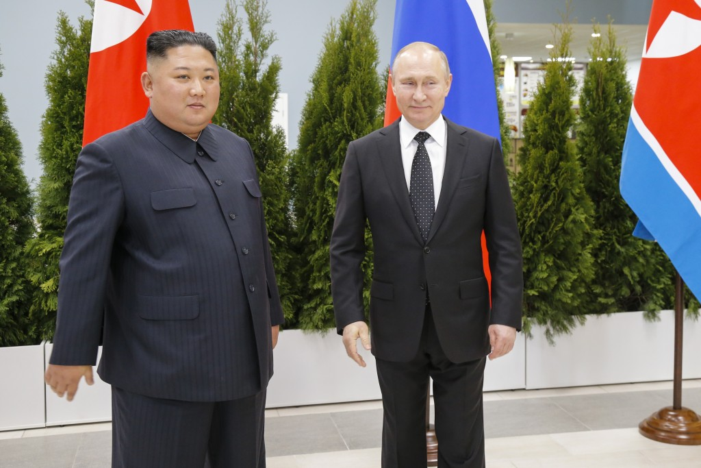 Russian President Vladimir Putin, right, and North Korea's leader Kim Jong Un pose for a picture during their meeting in Vladivostok, Russia, Thursday