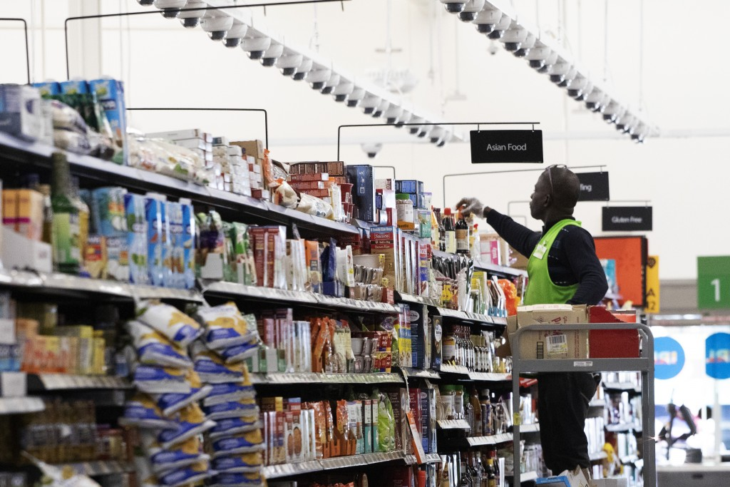 A Walmart associate arranges items on a shelf at a Walmart Neighborhood Market, Wednesday, April 24, 2019, in Levittown, N.Y. The cameras that are sus