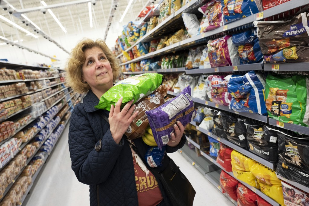 Marcy Seinberg shops at a Walmart Neighborhood Market, Wednesday, April 24, 2019, in Levittown, N.Y. Despite the signs and visible cameras many shoppe