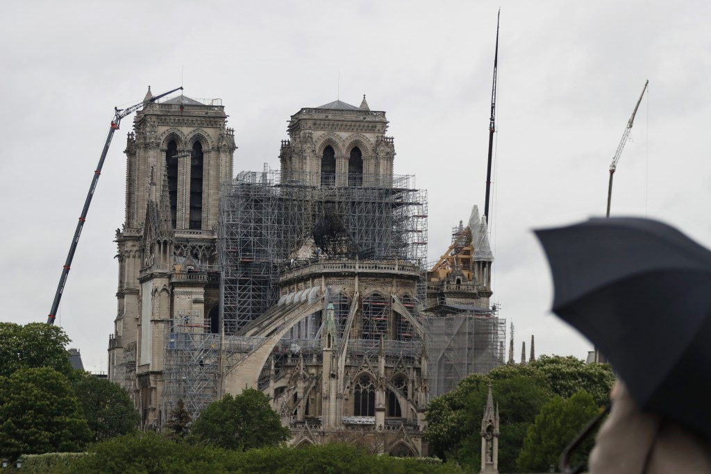 Cranes work at Notre Dame cathedral, in Paris, Thursday, April 25, 2019. French police scientists were starting to examine Notre Dame Cathedral on Thu...