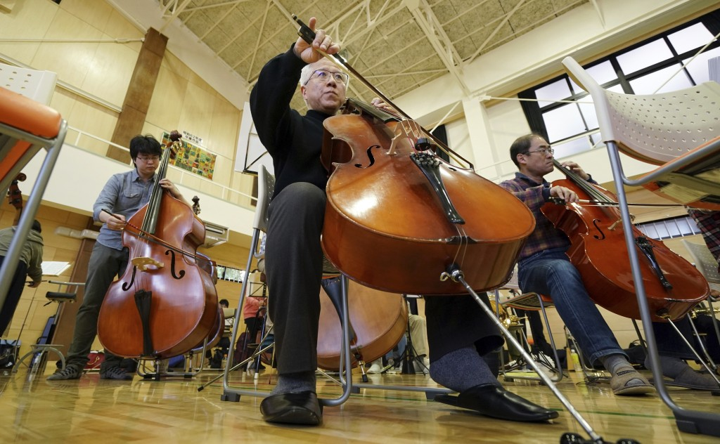 In this March 31, 2019, photo, Toshio Shiraishi, a longtime friend of Crown Prince Naruhito, plays his violoncello during a practice session of Shunyu...