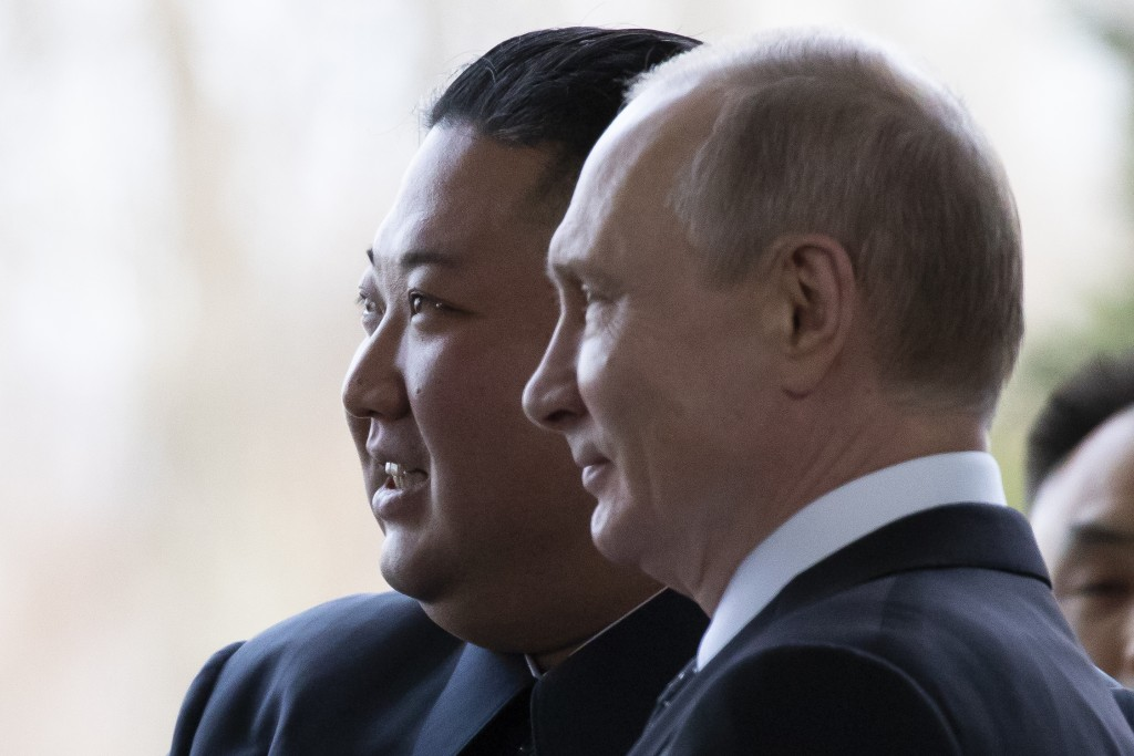Russian President Vladimir Putin, right, and North Korea's leader Kim Jong Un pose for a photo prior to their talks in Vladivostok, Russia, Thursday, ...