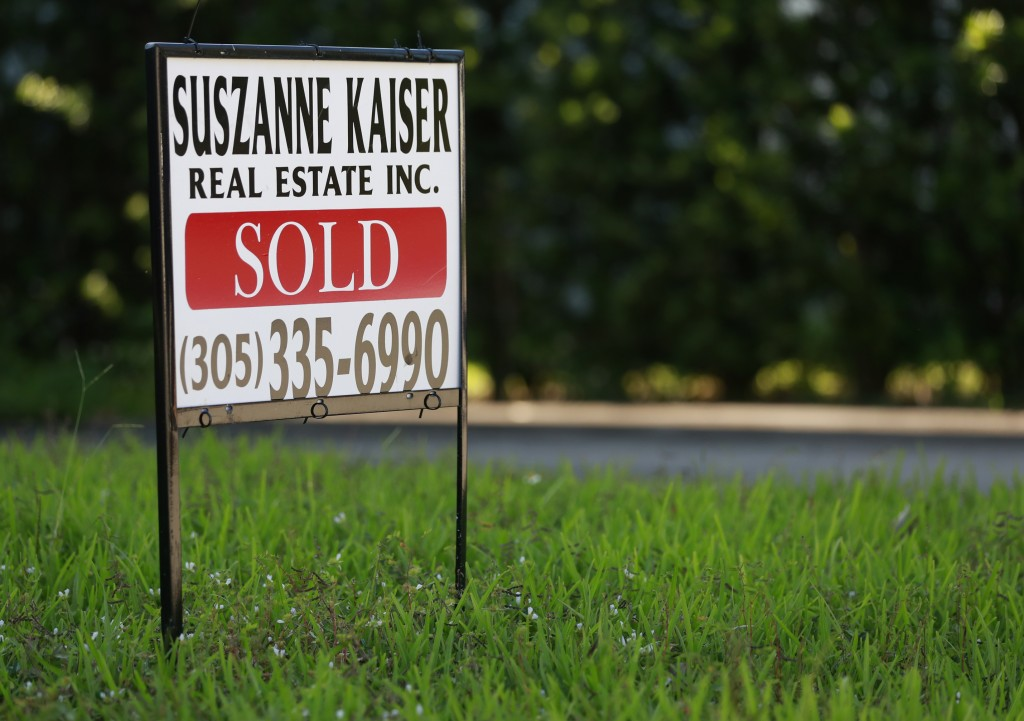 In this Friday, April 12, 2019 photo, a sold sign is shown in front of a home in Surfside, Fla. On Thursday, April 25, Freddie Mac reports on this wee...