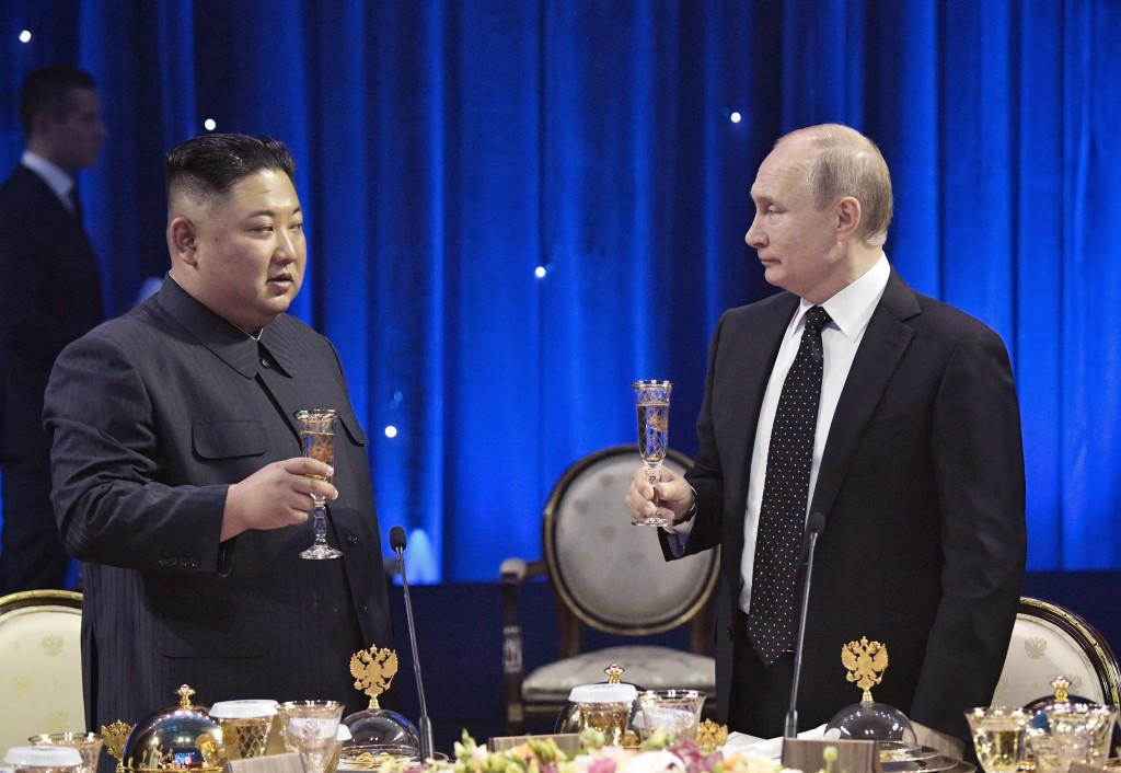 Russian President Vladimir Putin, right, toasts with North Korea's leader Kim Jong Un after their talks in Vladivostok, Russia, Thursday, April 25, 20...