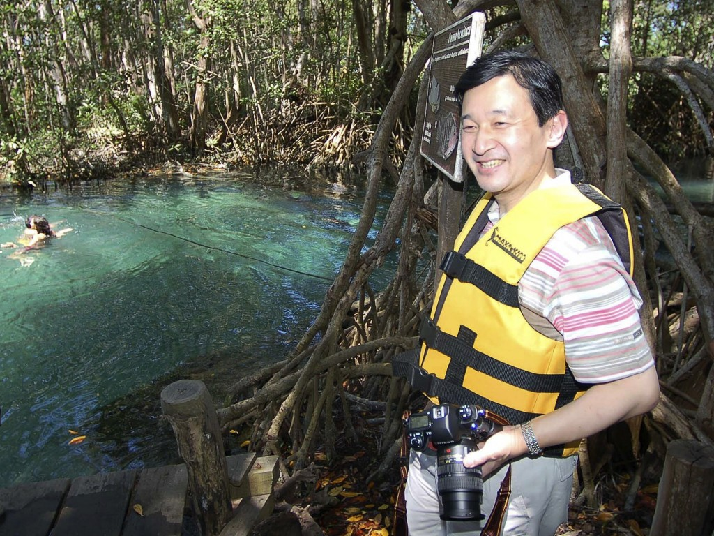 FILE - In this March 19, 2006, file photo, Japan's Crown Prince Naruhito looks out over a cenote, or sinkhole, during a visit to Celestun, Mexico. Cro...