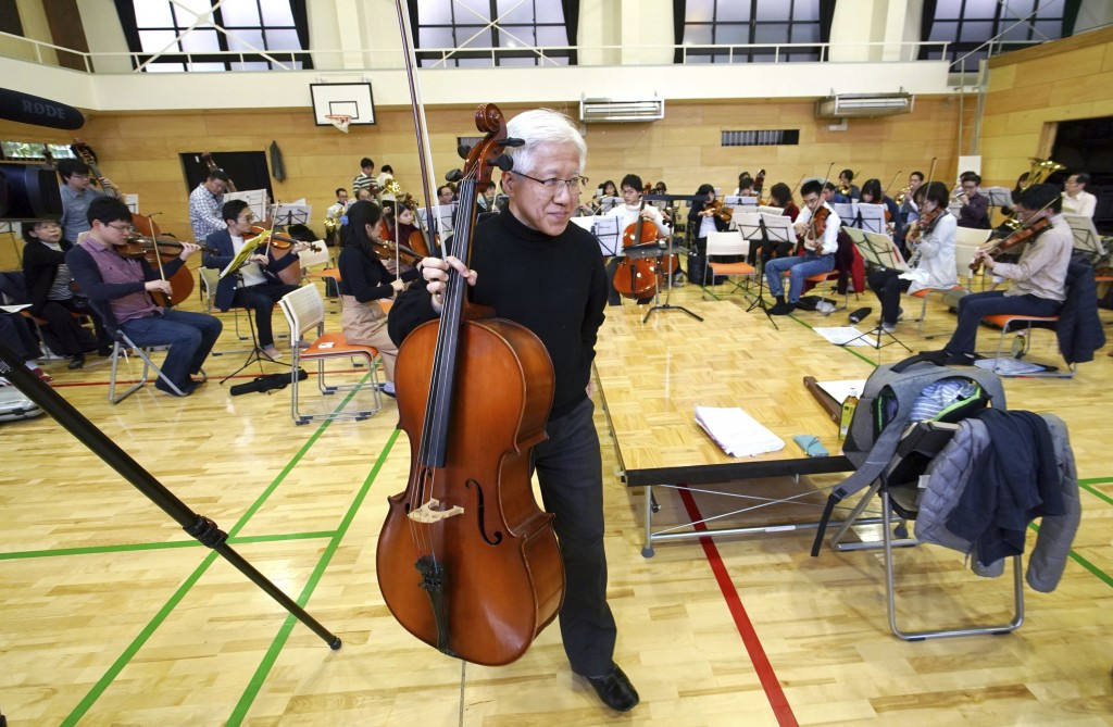 In this March 31, 2019, photo, Toshio Shiraishi, a longtime friend of Crown Prince Naruhito, holds his violoncello during a practice session of Shunyu...