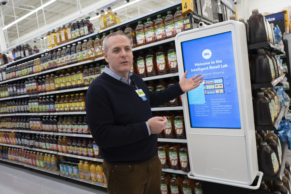 Mike Hanrahan, CEO of Walmart's Intelligent Retail Lab, discusses a kiosk that describes to customers the high technology in use at a Walmart Neighbor