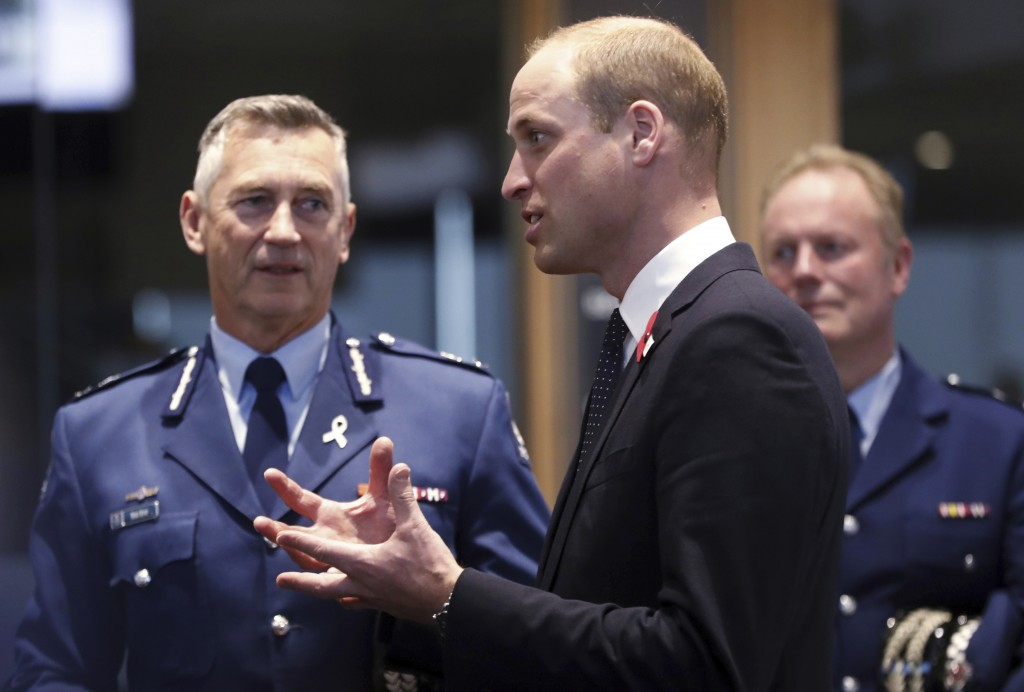 Britain's Prince William, center, meets with Police St. Johns ambulance staff during a visit to the Justice and Emergency Services Precinct in Christc...