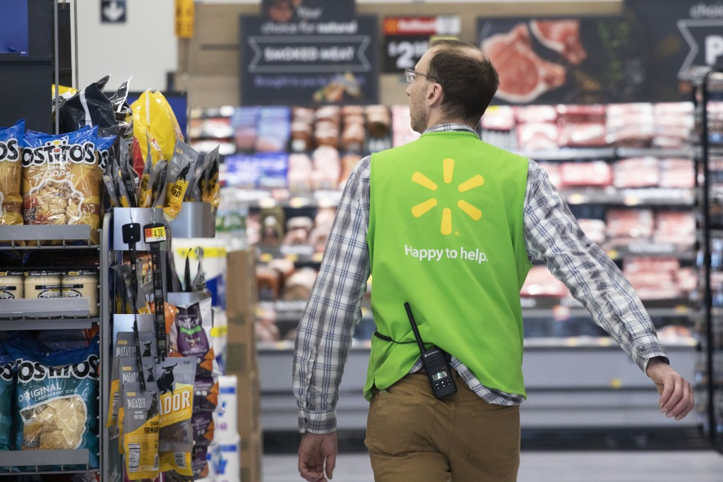A Walmart associate works at a Walmart Neighborhood Market, Wednesday, April 24, 2019, in Levittown, N.Y.  Inside one of Walmart's busiest Neighborhoo