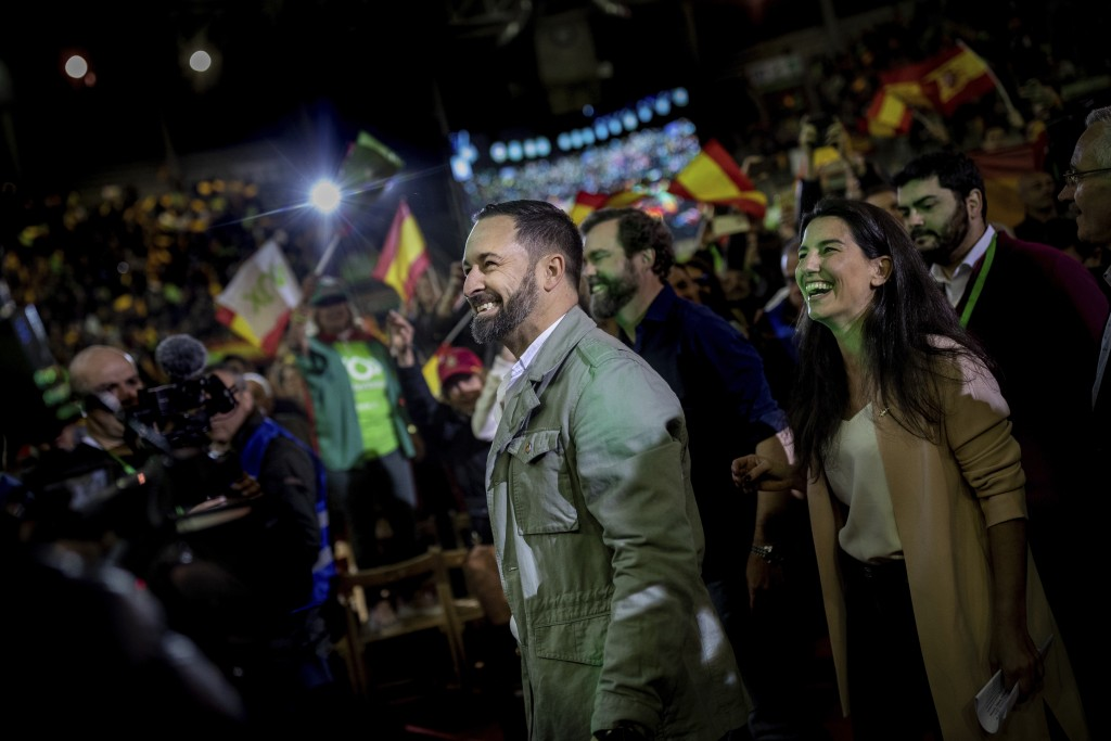 In this Saturday, April 6, 2019 photo, Spain's far-right Vox Party candidate Santiago Abascal smiles to supporters during a VOX event in Leganes, outs...
