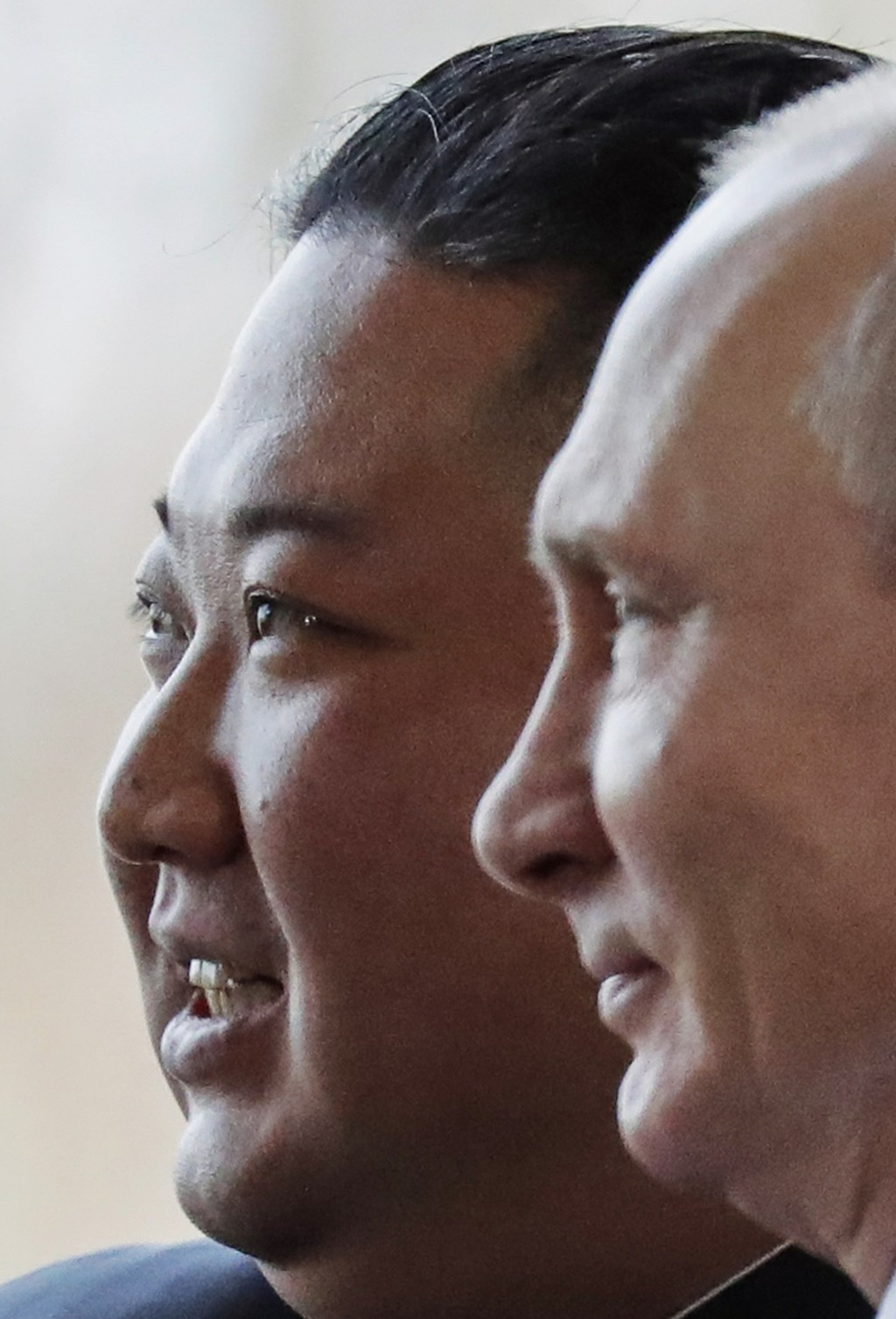 Russian President Vladimir Putin, right, and North Korea's leader Kim Jong Un pose for photographers during their meeting in Vladivostok, Russia, Thur