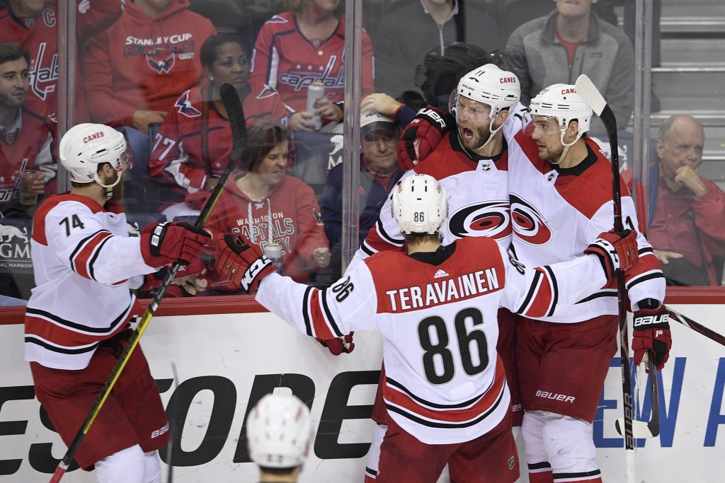 Carolina Hurricanes center Jordan Staal (11) celebrates his goal with right wing Nino Niederreiter, right, left wing Teuvo Teravainen (86), of Finland...