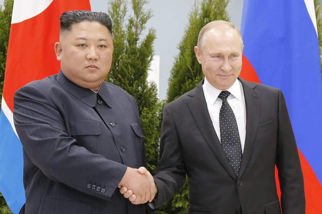 Russian President Vladimir Putin, right, and North Korea's leader Kim Jong Un shake hands during their meeting in Vladivostok, Russia, Thursday, April