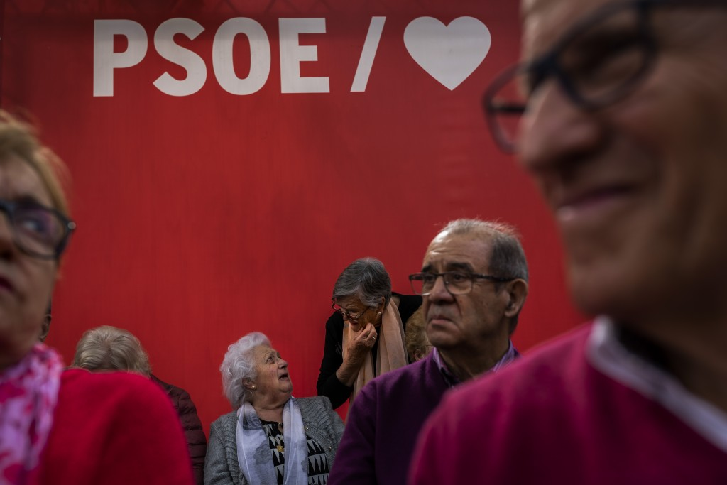 In this Monday, April 15, 2019 photo, Spanish retirees wait for the arrival of Prime Minister and Socialist Party candidate Pedro Sanchez at an electi...