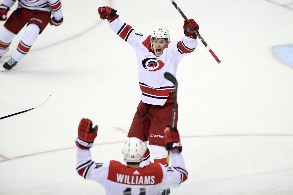Carolina Hurricanes left wing Brock McGinn (23) celebrates his game-winning goal with Justin Williams (14) in double overtime of Game 7 of an NHL hock...
