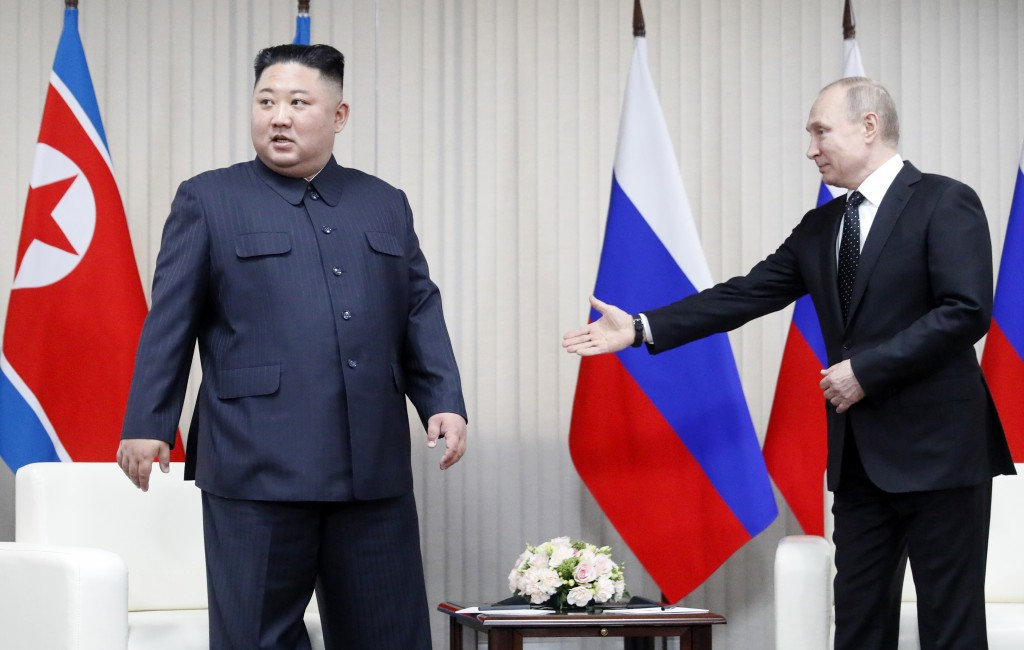 Russian President Vladimir Putin, right, welcomes North Korea's leader Kim Jong Un before their one-one-one talks in Vladivostok, Russia, Thursday, Ap