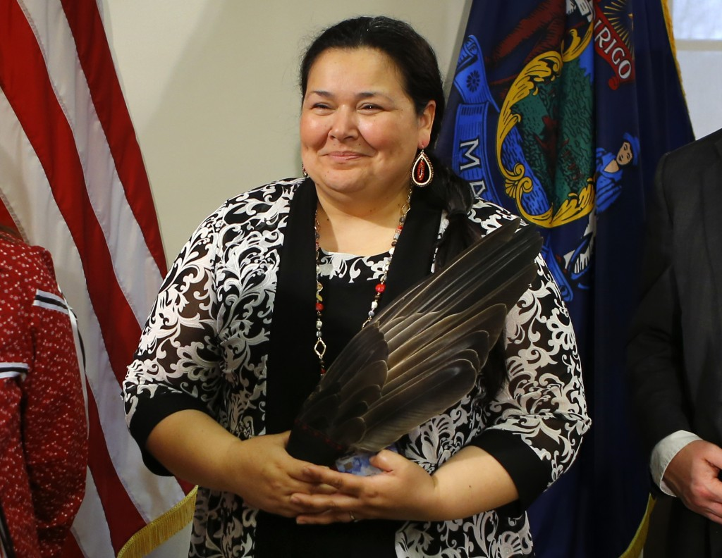 Clarissa Sabattus, Tribal Chief of the Houlton Band of Maliseet Indians, holds eagle feathers during the signing ceremony to establish Indigenous Peop...