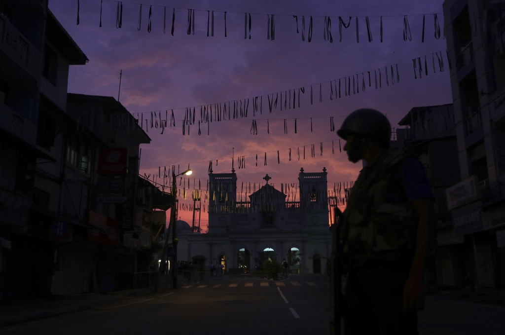 A Sri Lankan Army soldier stands guard in front St. Anthony's Church in Colombo, Sri Lanka, Friday, April 26, 2019. Priests have allowed journalists i