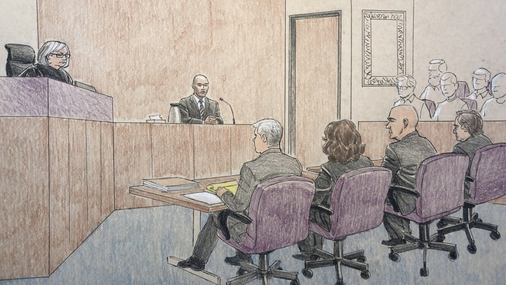This courtroom sketch depicts former Minneapolis police officer Mohamed Noor, center, on the witness stand Thursday, April 25, 2019, in Minneapolis du...