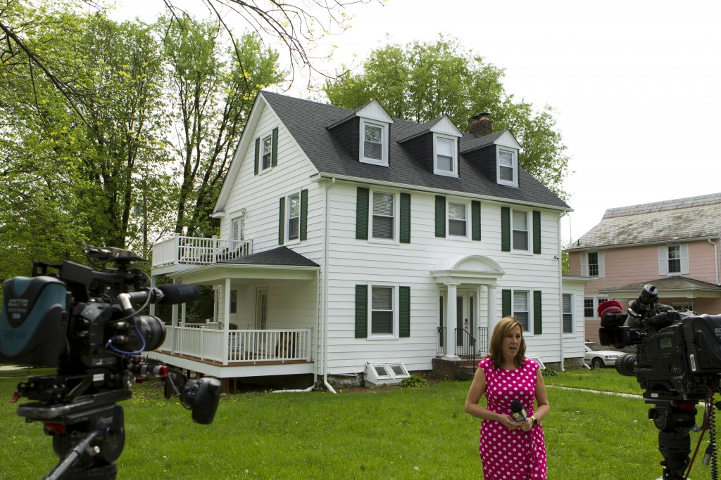 TV crews report form outside the house of Baltimore Mayor Catherine Pugh in Baltimore, MD., Thursday, April 25, 2019. Agents with the FBI and IRS are ...