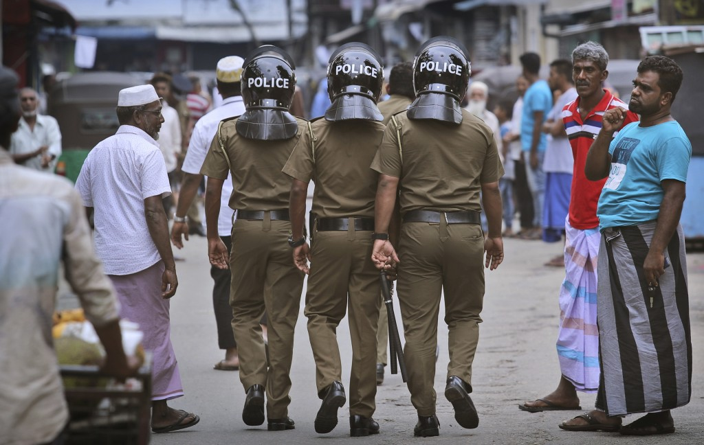 Sri Lankan policeman patrol in a Muslim neighborhood before Friday prayers in Colombo, Sri Lanka, Friday, April 26, 2019. Across Colombo, there was a ...