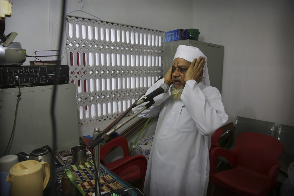 A Sri Lankan Muslim priest calls for Friday prayers from a mosque, in Colombo, Sri Lanka, Friday, April 26, 2019. Across Colombo, there was a visible