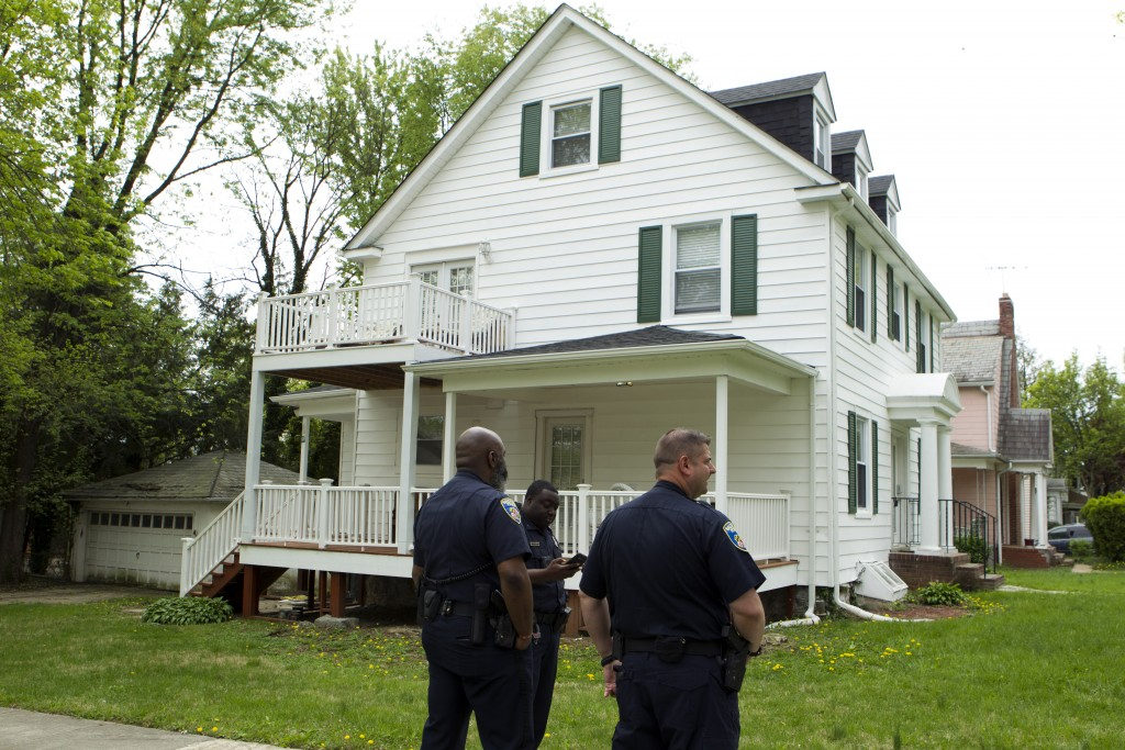 Baltimore police officers stand outside the house of Baltimore Mayor Catherine Pugh in Baltimore, MD., Thursday, April 25, 2019. Agents with the FBI a...