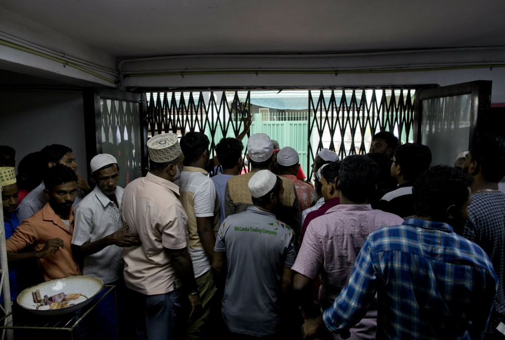 Muslim men leave a mosque after Friday prayers in Colombo, Sri Lanka, Friday, April 26, 2019. Religious leaders cancelled large public gatherings amid