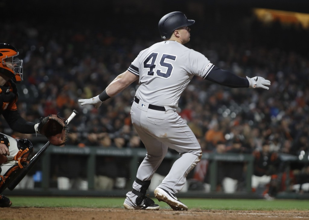New York Yankees' Luke Voit watches his two run home run hit off San Francisco Giants' Mark Melancon in the ninth inning of a baseball game Friday, Ap