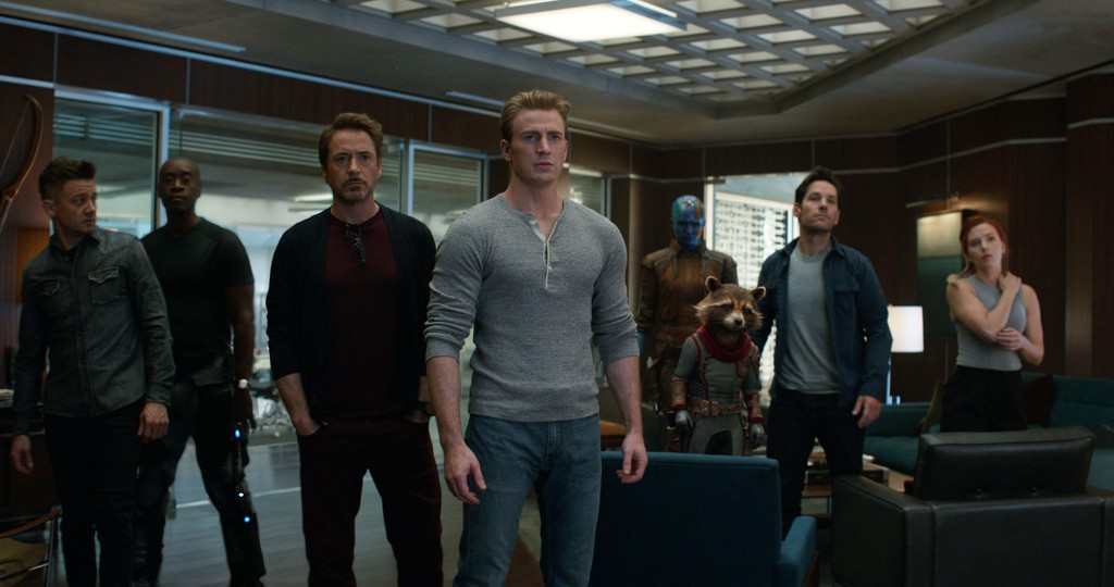 This image released by Disney shows, from left, Jeremy Renner, Don Cheadle, Robert Downey Jr., Chris Evans, Karen Gillan, the character Rocket, voiced...