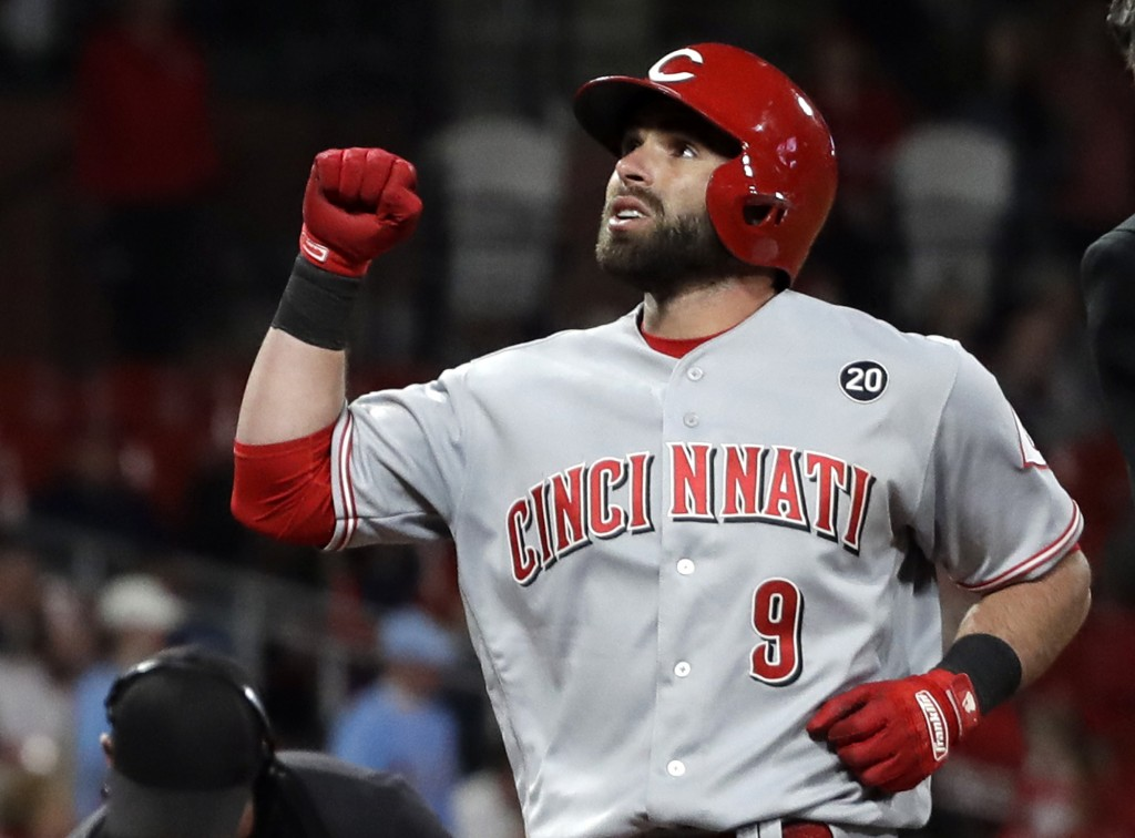 Cincinnati Reds' Jose Peraza celebrates as he reaches home on a solo home run during the ninth inning of a baseball game Friday, April 26, 2019, in St...
