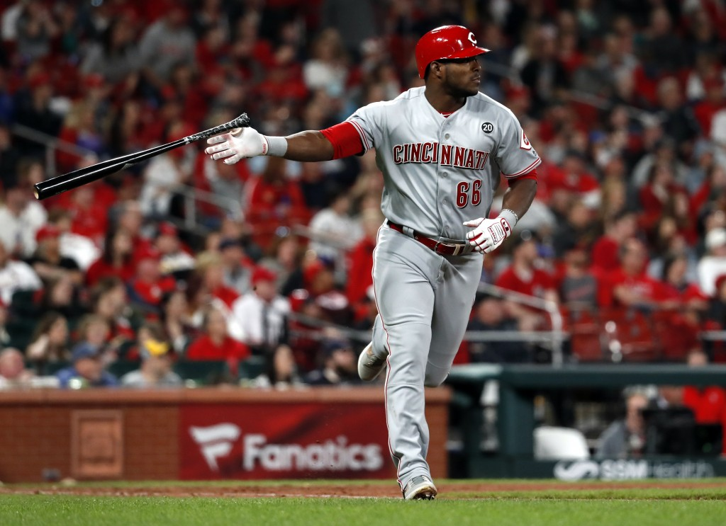 Cincinnati Reds' Yasiel Puig tosses aside his bat as he watches his two-run home run during the eighth inning of a baseball game against the St. Louis...